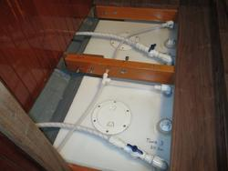 Intalling water tanks, installing vent lines in boat water tanks, restoration of a sailboat.